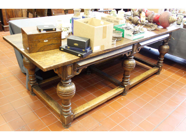 A Tudor style elm refectory type dining table,