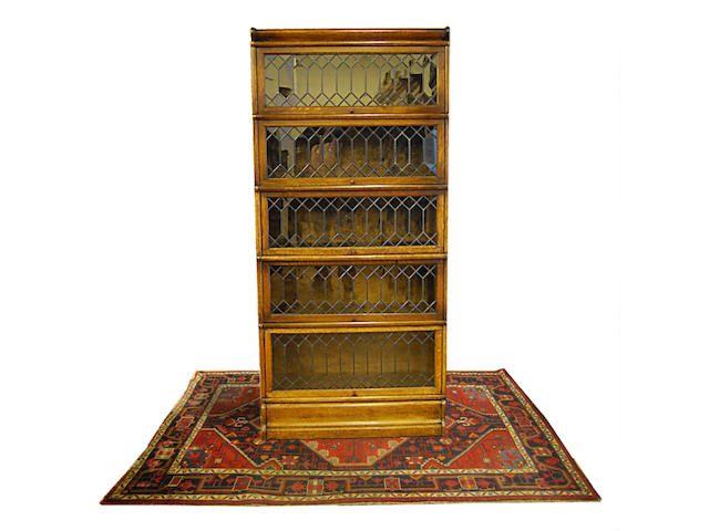 An oak Globe Wernicke stacking bookcase With printed Globe Wernicke label to the third shelf