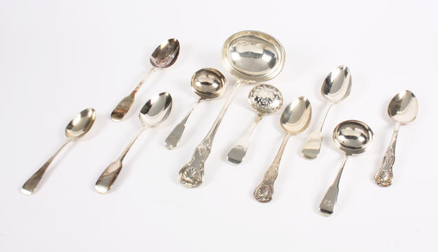 A Victorian Kings pattern soup ladle, George Maudsley Jackson, 1895,  George Maudsley Jackson, 1895, double struck, crested, two similar tablespoons, Victorian Old English dessert spoon, and six items of fiddle pattern flatware, a pair of sauce ladles, C & T Barker 1802, crested, sifter spoon, 1834, monogrammed, pair of tablespoons, 1838 and another 1824 , weight 31oz. (10)