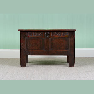 An early 18th Century small oak coffer, dated 1728