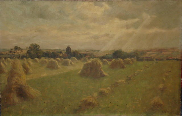 John William Gilroy (British, Newcastle Upon Tyne 1868-1944 Whitley Bay, Northumbria) Country landscape with corn stooks, with a village beyond,