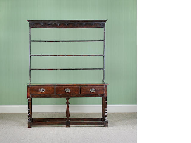 An early 18th Century style oak high dresser