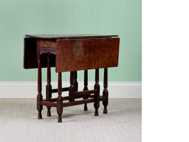An oak gateleg occasional table, circa 1700