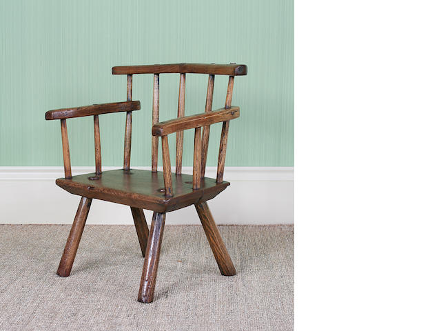 An early 19th Century ash and painted primitive child's chair, Irish