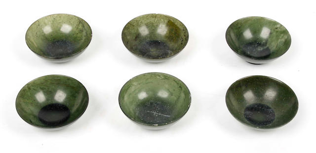 A set of six Chinese spinach-green jade miniature saucer dishes