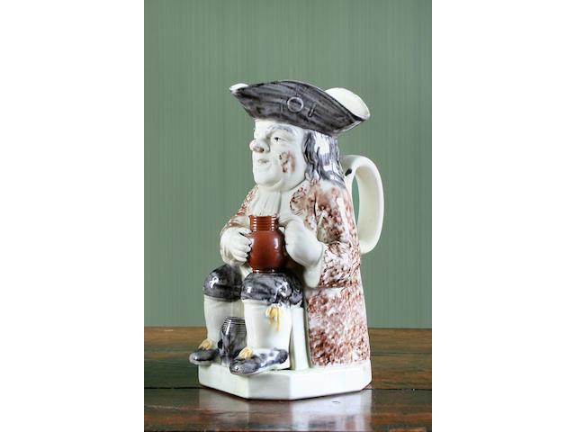 A Wood type creamware Toby jug, circa 1770