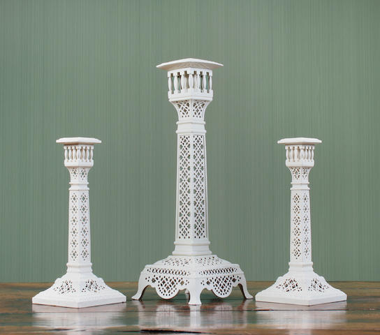 A composite garniture of three Leeds pottery reticulated creamware candlesticks Circa 1780