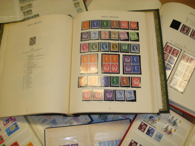 A quantity of stamps mixed including world and United Kingdom in several albums
