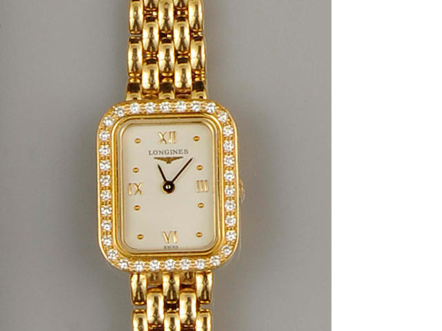 Longines: An 18ct gold diamond set lady's wristwatch