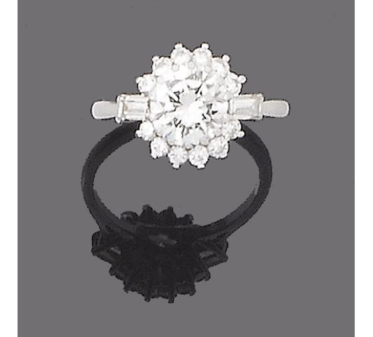 A diamond cluster ring, by Boodle and Dunthorne