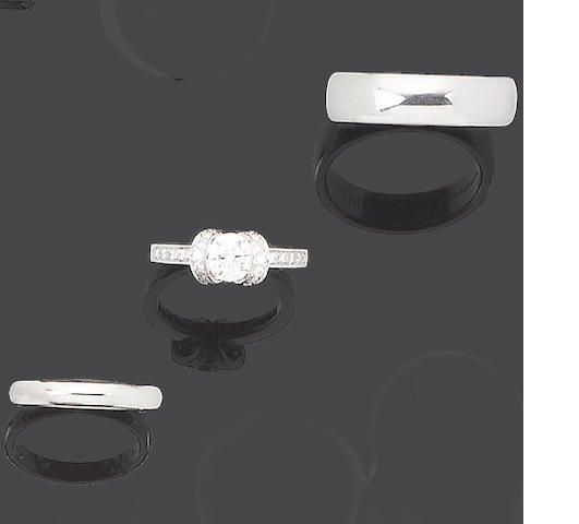 A diamond single-stone ring and a pair of wedding bands, by Tiffany & Co. (3)