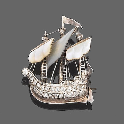A mother-of-pearl and diamond brooch,