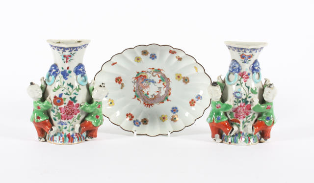 A pair of Chinese export figural wall pockets and a Kakiemon style dish 19th Century.