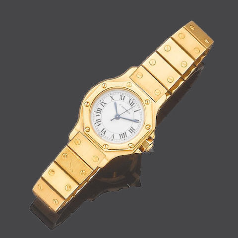A lady's 18ct gold automatic wristwatch, by Cartier Santos