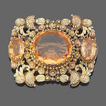 A topaz and gold brooch,
