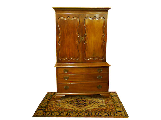 A mahogany cupboard on chest, in 18th Century style