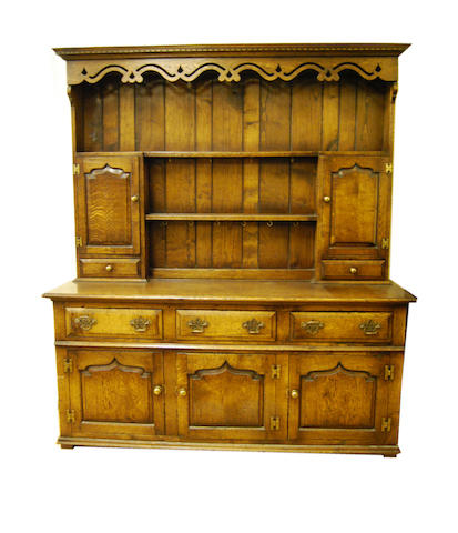 A good reproduction oak high dresser, in 18th Century style