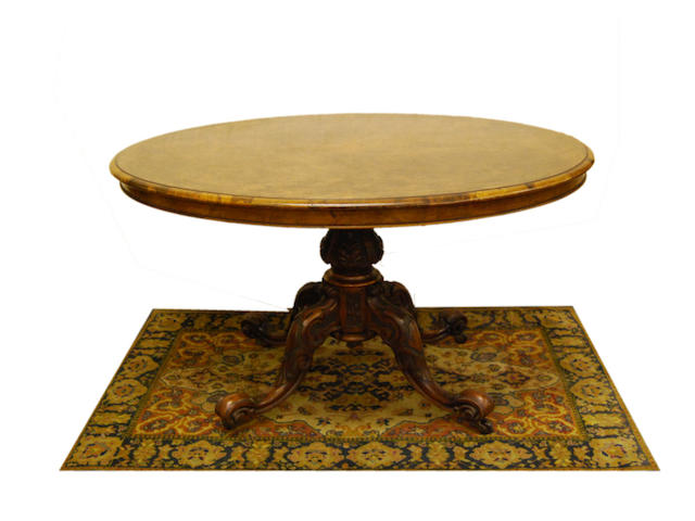 A Victorian figured walnut loo table The top stamped 3635, the base stamped 3637