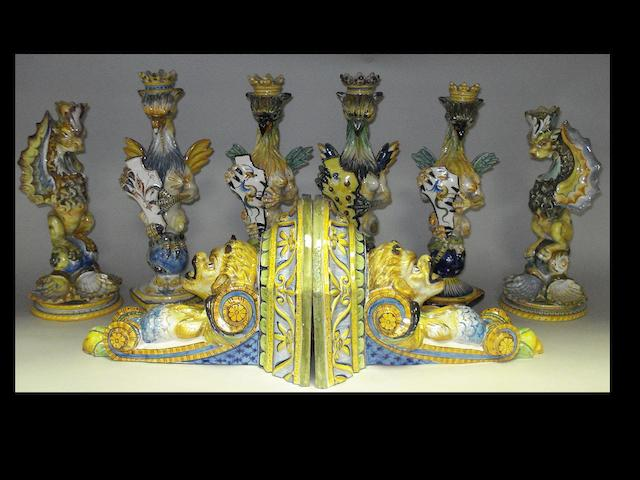 A pair of maiolica wall brackets and six candlesticks.(8)