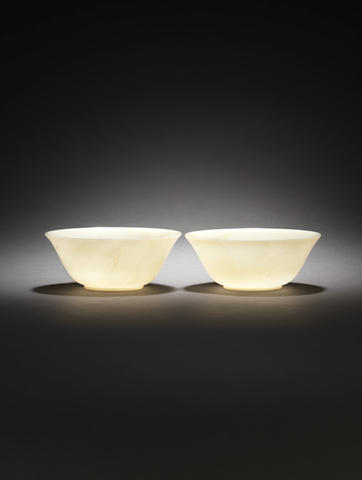 A pair of pale green jade bowls 19th century