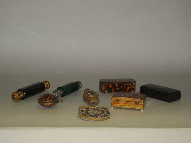A Victorian green glass double ended scent bottle, with gilt metal stoppers, 15cm long, another similar, a beadwork purse, a miniature flask and four various tortoisehell and other small boxes.