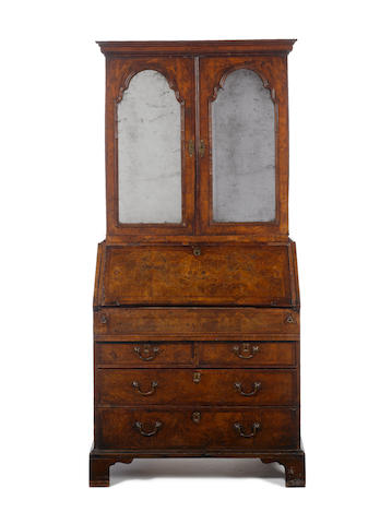 A Queen Anne figured walnut, crossbanded and featherbanded Bureau Cabinet