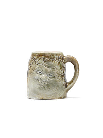 Robert Wallace Martin  A grotesque double-face Mug, circa 1880