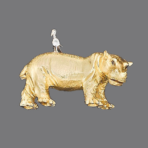 A gold and gem-set hippo brooch, by Tiffany & Co.