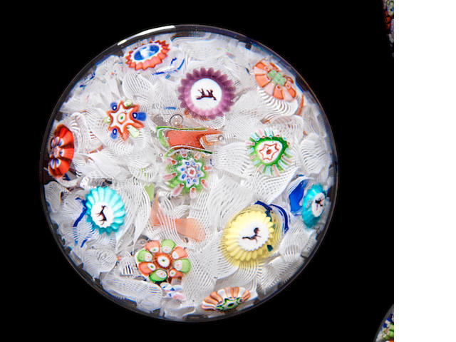 A Baccarat spaced millefiori paperweight dated 1848