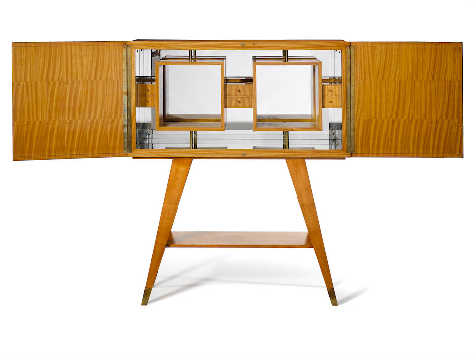 Gio Ponti an important and unrecorded fruitwood and vellum cabinet, circa 1941-42 with brass fittings, the mirrored interior with a series of fitted drawers, also with original key