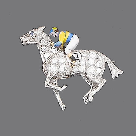 A diamond and enamel jockey brooch