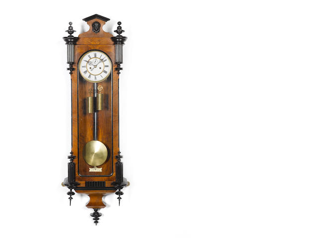 A late 19th century twin weight Vienna style walnut and ebonised wall clock  The movement numbered 79240