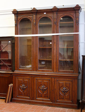 A Victorian mahogany library bookcase,with breakfront cornice above three glazed panel, doors enclosing adjustable shelves and cupboard base under, 265cm high x 186cm wide.