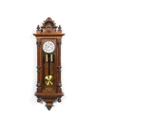 A late 19th century carved walnut twin-weight Vienna style wall clock  The movement numbered 96621
