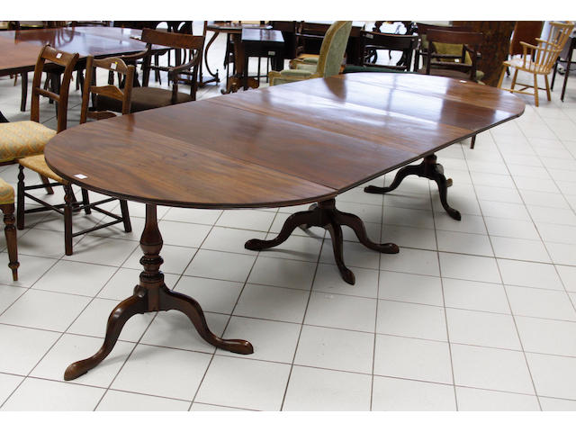 A Georgian style mahogany triple pillar dining table,