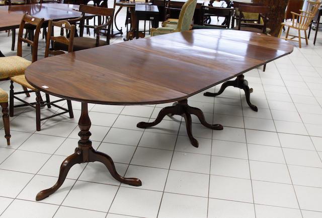 A Georgian style mahogany triple pillar dining table,
