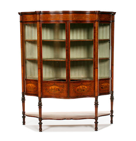 A fine Edwardian satinwood, mahogany, penwork and marquetry serpentine display cabinet by Maples