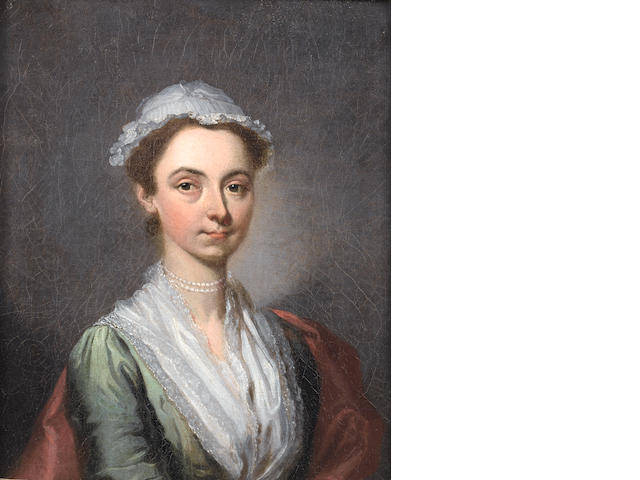 Circle of Francis Hayman (Exeter 1708-1776 London), circa 1741 Portrait of a lady, said to be a member of the Gough family, burst-length in a green dress with a white lace, a red wrap and a white lace cap, wearing pearls