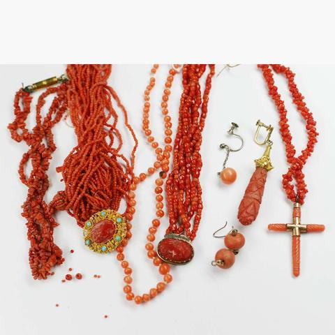 Various strings of coral beads, some carved, odd coral earrings.