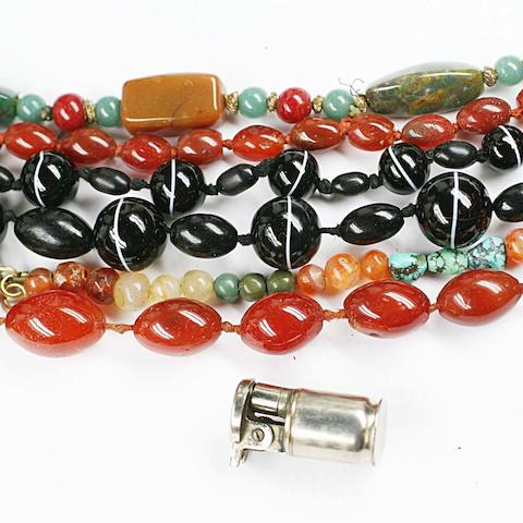 A string of black banded agate beads, three strings of polished cornelian and hardstone beads, and others loose.