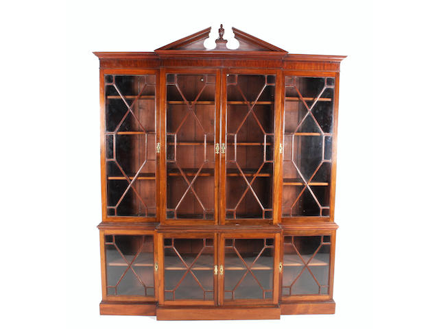 A George III style mahogany breakfront bookcase, 19th century