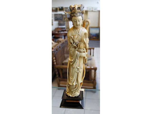 An ivory carving of a standing maiden Circa 1900