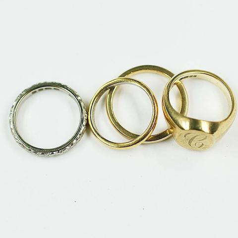 A 9ct gold signet ring, engraved 'C', a 9ct wedding band, a two colour platinum lined wedding band and an 18ct gold textured band. (4)