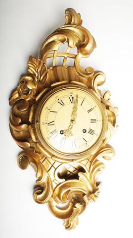 A reproduction 20th century giltwood Cartel clock Exacta