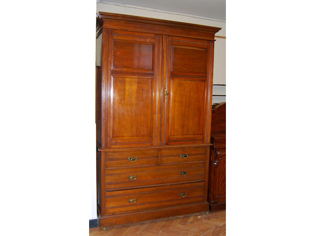 An Edwardian walnut press cupboard