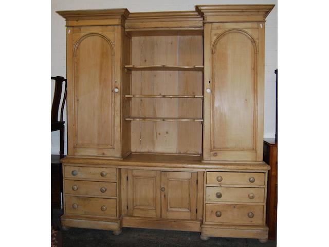 A Victorian pine breakfront high dresser