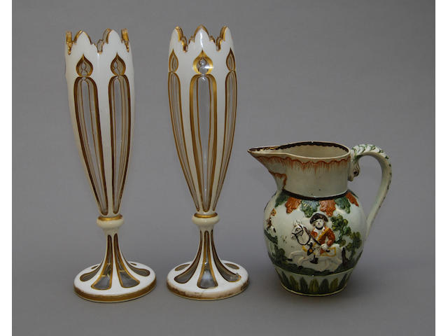 A Pratt ware jug and a pair of overlaid vases
