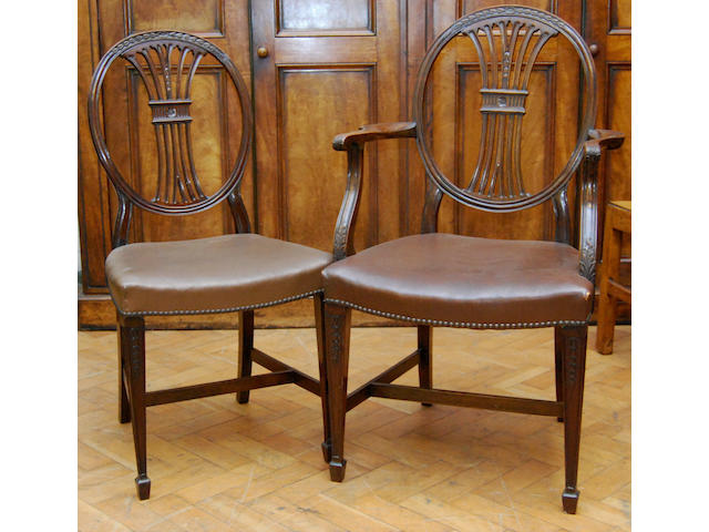 A set of eight mahogany Hepplewhite-style dining chairs