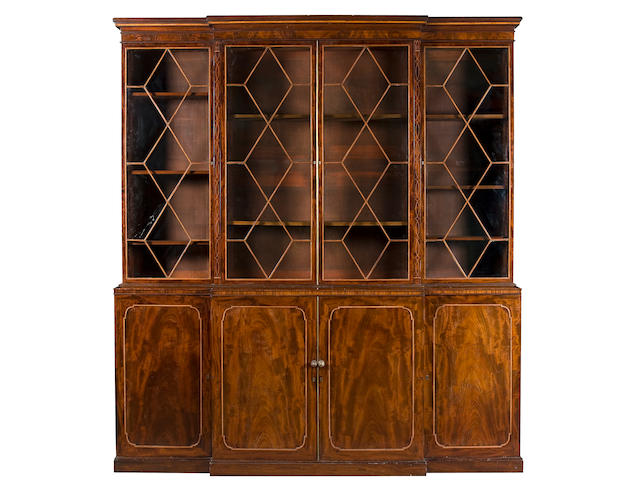 A Regency mahogany and satinwood banded breakfront bookcase