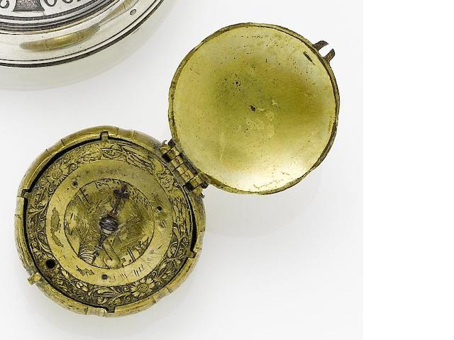 A mid to late 18th century brass cased form watch